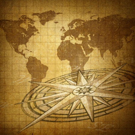 Global direction and world trade business with a rustic grunge map of the earth and a compass as an international symbol of making financial investing decisions and deciding where to invest  or travel to photo