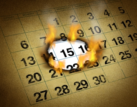 burning time: Setting an important hot date on a grunge calendar on fire burning a hole to remember and mark a day of the month representing organizing important urgent time and schedule reminder  Stock Photo