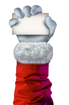 seasonal symbol: Santa Claus mano que sostiene una tarjeta en blanco como signo festivo de Navidad o s�mbolo alegre temporada de invierno con el guante blanco con textura y abrigo rojo con borde de piel aislado en un fondo blanco Foto de archivo