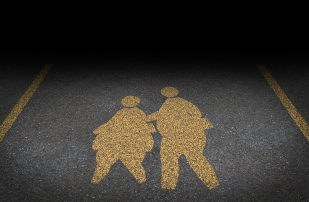 overweight students: Obesity in children and childhood obese concept with a yellow painted asphalt road sign Stock Photo