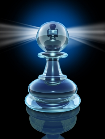 Potential inside and the power within to transform into a great leader by looking inside as a transparent glass chess pawn with a king piece hidden at the core with a glowing light on black  photo