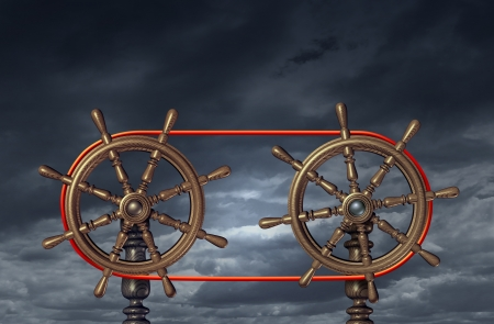 Team leadership and business relationship based on a mutual agreement on collaborating and  partnership vision with two ship wheels connected with a red rope  photo