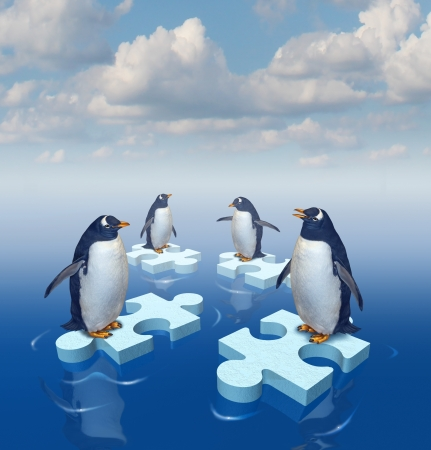 Coming together with common purpose to assemble a team partnership to form a strong group with four penguins merging floating chunks of ice in the shape of puzzle pieces as insurance
