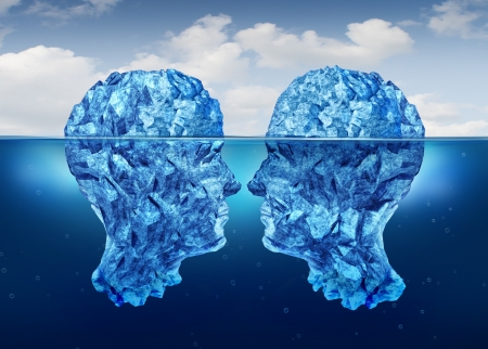 Hidden relationship and secret partnership as two icebergs shaped as human heads face to face concealed underwater as a clandestine meeting