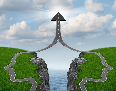Bridge the gap and bridging the differences between two business partners over a financial cliff to merge together for team success as a strong partnership with two head shaped roads merging as an upward arrow  Imagens