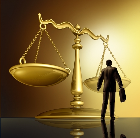 enforcing the law: Lawyer and the law with a justice scale made of brass gold metal on a glowing background as a symbol of the legal advice, system in government and society in enforcing rights and regulations