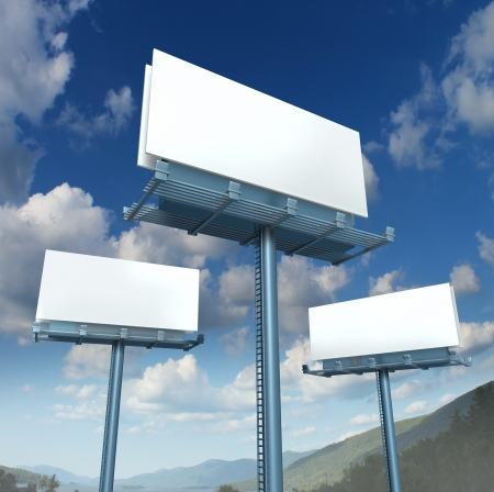Billboards blank advertising signs in three dimensional perspective as horizontal angled outdoor marketing with copy space on a blue sky Stock Photo - 16920764