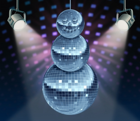 disco era: Winter holiday music symbol with Dance night disco balls as a mirror sphere in the shape of a snowman for festive fun and new year celebrations dancing party in a nightclub or dance club with glowing stage lights  Stock Photo