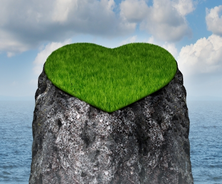 Valentine heart shaped mountain cliff island surrounded by water as a lonely and romantic symbol of the challenges of dating and searching for a loving relationship and abstinence from sex  Stock Photo - 17032222