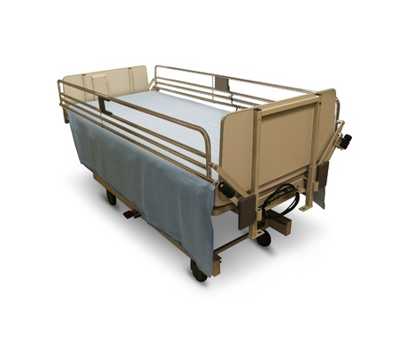 Hospital bed or medical stretcher on a white background as a health care symbol of patient needs and surgery recovery with side rails and an adjustable height as emergency safety equipment