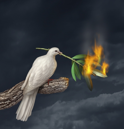 Peace crisis concept with a white dove standing on a tree holding an olive branch on fire as a symbol of the challenges of war fighting and revolution and the elusive search for a truce or agreement in the middle East or other countries in conflict