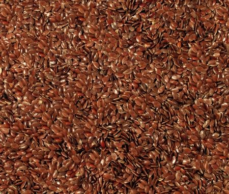 Flax seed cereal and grain texture as a symbol of healthy eating by growing and eating high fiber brown organic flaxseed as a health freindly whole food choice Stock Photo - 17335539