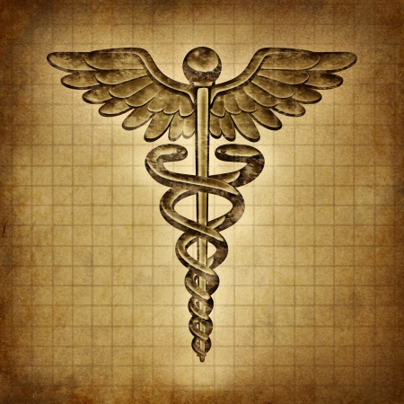 caduceus: Caduceus on an old grunge parchment document as a vintage medical symbol and health care and medicine icon with snakes crawling on a pole with wings as a pharmacy medicine concept  Stock Photo
