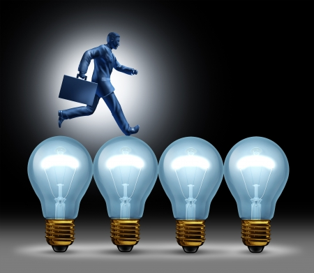 patents: Creative bridge business concept with a man in a suit running on lightbulbs using ideas to move forward with innovation and wealth on a black background  Stock Photo