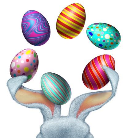 seasonal symbol: Conejo de Pascua con malabares piel blanca decorada con huevos festivos orejas de conejo grande con un �rea en blanco blanco como s�mbolo de temporada de primavera diversi�n y celebraci�n