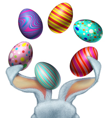 Easter bunny with white fur juggling decorated festive eggs using his big rabbit ears with a blank white area as a seasonal symbol of spring fun and celebration Stock Photo - 17688043