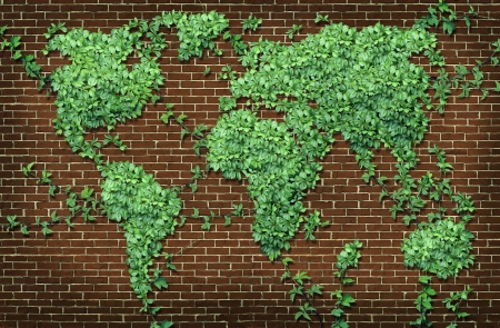 brick earth: Global leaf map in the shape of growing green vine plant on a red brick wall as a world concept of network connections with the Americas and Europe and Africa Asia Australia attached through natural branches