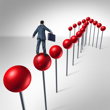 locating: Finding success and planning a strategy to find opportunity as a business man climbing red pushpins in the shape of an upward arrow to financial security   Stock Photo