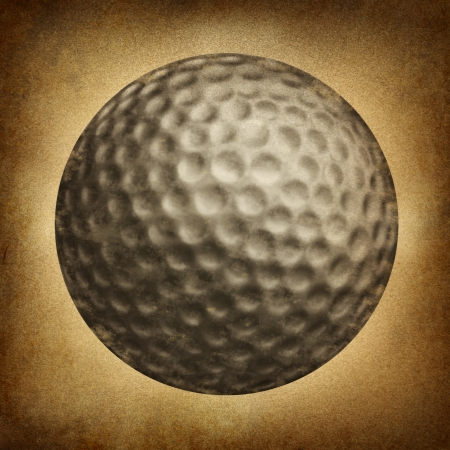 retro: Golf ball in an old vintage grunge texture on parchement paper as a traditional sporting symbol of  an individual leisure game played on an eighteen hole course