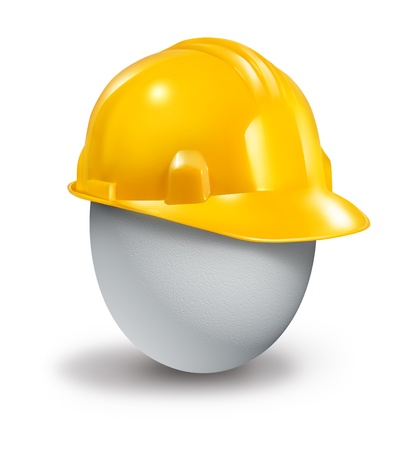 Health insurance protection symbol and managing risk and physical care concept with a yellow plastic hard hat protecting a fragile white egg from injury and accidents Stock Photo - 17811892