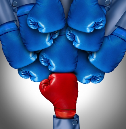 Overcoming adversity and conquering challenges as a group of blue boxing gloves ganging up on a single red glove as a business symbol of difficult competition environment,