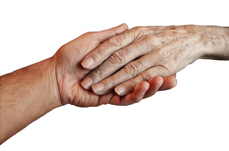 charitable: Senior Care with the hand of a young person holding and helping an old and elderly retired patient needing in home medical help due to aging and memory loss on a white background