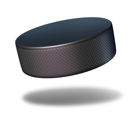 puck: Hockey puck sport equipment flying in mid air on a white background as a winter sports symbol for professional or amateur game play in an ice rink