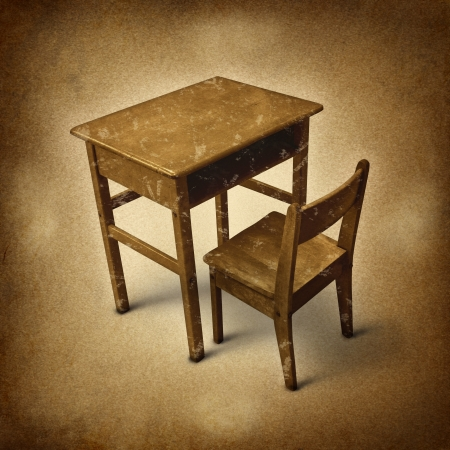 old furniture: Old school desk symbol of education and learning in simpler times as a bigone old fashined era with vintage wooden student furniture on a dirty background