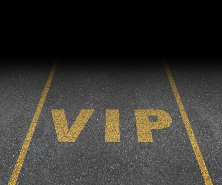 vip area: VIP service symbol with a first class reserved parking space for with a sign painted on asphalt as a symbol of exclusive hospitality with the royal treatment with a blank area for text  Stock Photo
