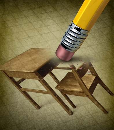 reform: Fixing education and school crisis concept with an image of a vintage student desk being erased by a pencil eraser as a concept of the stress and anxiety of bad grades and the need for academic reform  Stock Photo