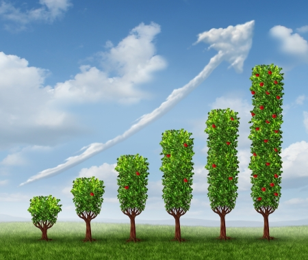 tree growing: Business growth success as a financial graph shaped as growing trees with fruit and a cloud in the shape of an upward arrow as a concept of investment wealth bearing fruit  Stock Photo
