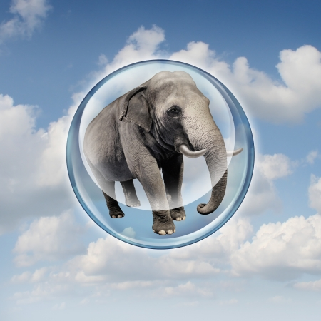 Power of possibilities concept with a realistic elephant lifted in the air in a bubble sphere as a business symbol of achievement and elevation in abilities to succeed in upward growth  Archivio Fotografico
