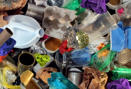 Recycling garbage and reusable waste management as old paper glass metal and plastic household products to be reused as a concept of environmental conservation of material saving energy and money Stock Photo - 18283512