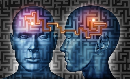 telepathy: Communication solutions and mind control with a group of communicating human heads on a labyrinth or maze pattern with a laser light connecticn the thinking network of two brains  Stock Photo