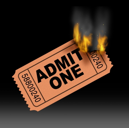 Hot ticket entertainment concept with a best selling admit one paper entrance stub burning in flames with fire and smoke  as a symbol of very popular in demand movie and cinema media  Stock Photo - 18410789