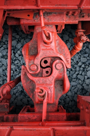coupling: Strong connection with red train car metal coupling connected together as a business symbol of strength in partnership and an unbreakable agreement or contract between two team members  Stock Photo