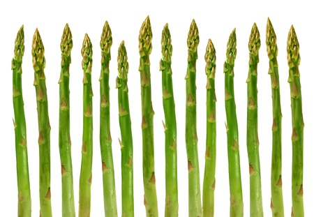 diet concept: Asparagus group of green healthy vegetables organized in a row isolated on a white background as a food concept of health diet and living a natural fit well nourished life