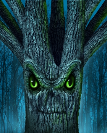 cursed: Haunted tree with a mythical dark forest and an evil plant shaped as a demon spirit skull face as a halloween or ghost related concept of monsters and imaginary creatures from folklore  Stock Photo
