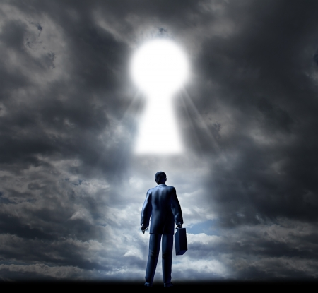 Key to business success with a businessman standing with a briefcase looking into a glowing key hole opening in the cloudy sky as a concept of future opportunity and aspirations  Zdjęcie Seryjne