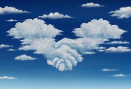 colaboracion: Contrato visi�n acuerdo en una reuni�n de un grupo de dos c�mulos de nubes en un cielo azul con forma de manos de los hombres de negocios que se unen para formar una colaboraci�n s�lida para el futuro Foto de archivo
