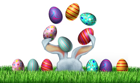 Easter fun with a hiding cute white bunny rabbit and ears juggling festive painted eggs in an egg hunt green grass environment as a concept of spring and holiday celebrations on a white background Stock Photo - 18699829