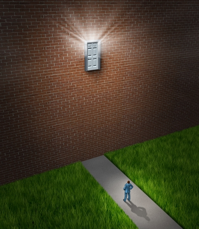 unreachable: Hard goals as a business concept for opportunities that are out of reach as a businessman standing in front a huge brick wall from a house or building with a high unaccessible door that is shinning light