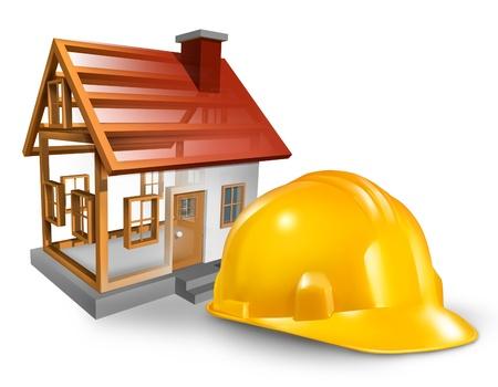 Woningbouw en thuis bouwer concept met een gele werknemer helm en een residentiële structuur wordt gebouwd op een witte achtergrond Stockfoto
