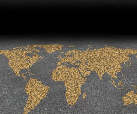 overpopulation: International city travel and global street festival tourism concept with an asphalt road with a world map painted with yellow paint on the rough surface as a symbol of worldwide travel guide for cities  Stock Photo