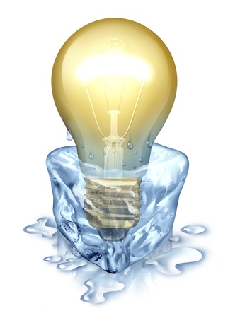 Fresh thinking with an illuminated light bulb emerging by melting away from an ice cube as a creativity business concept to set your imagination free as innovative problem solving on white  Archivio Fotografico