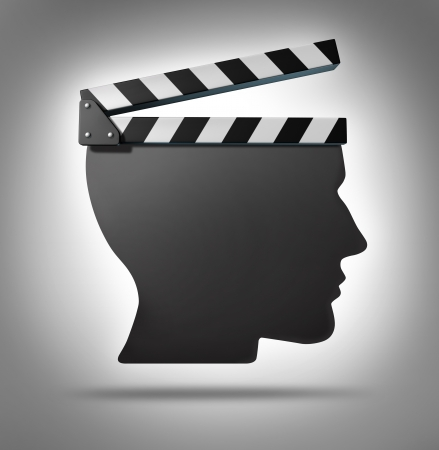 behaviour: Life direction and human guidance as a symbol of a movie equipment clapboard shaped as a head ins a concept for living and taking action in your biography  Stock Photo