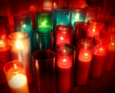 candlelight memorial: Spiritual candles as a candlelight memorial in a religious ceremony as a commemorative tradition in religion to celebrate the life of loved ones with church prayers of hope and respect