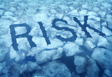Risk and danger as a thin ice concept with the word imbedded in a cracked frozen lake warning any person to be very cautious as a business symbol of hazardous situation that is very dangerous Stock Photo - 18982389