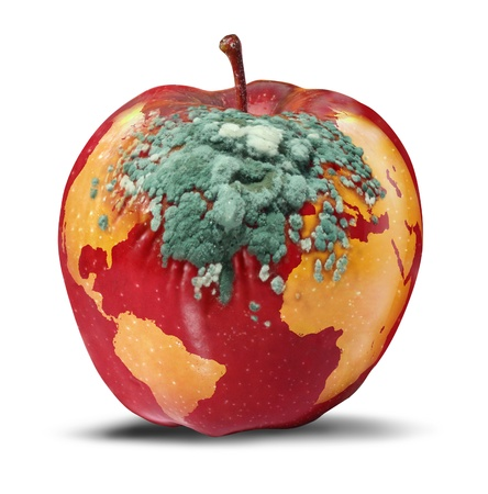 Global problems and environmental Issues concerning the health of the planet earth as a decaying red apple with a map of the world rotting with growing green fungus as a concept of political and conservation crisis on white