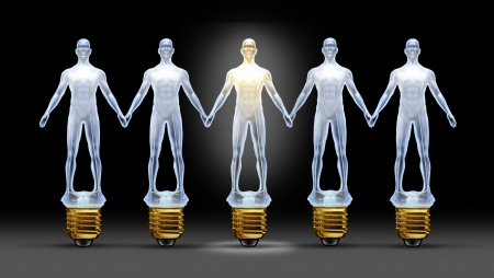 shinning: Community ideas with a group of light bulbs shaped as business people holding hands with a leader person illuminated shinning bright as a concept of creative team success through connections and networking  Stock Photo